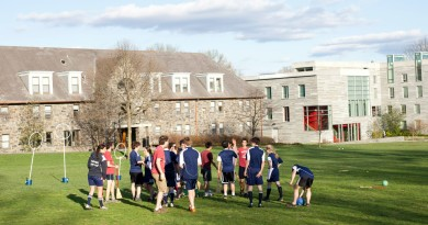 Swarthmore's Quidditch team plays a match on Mertz FieldPhoto by Kat Clark '12