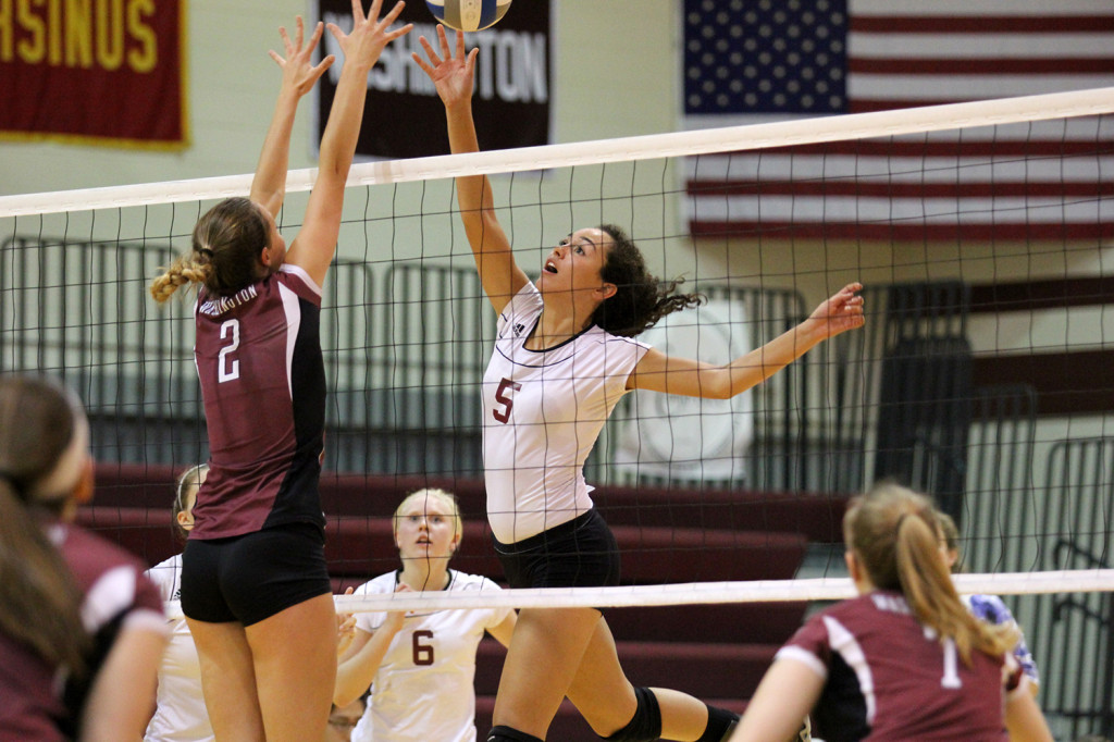 Senior Chastity Hopkins, shown here gearing up for a spike, hopes to guide Swarthmore to continued success on the court.