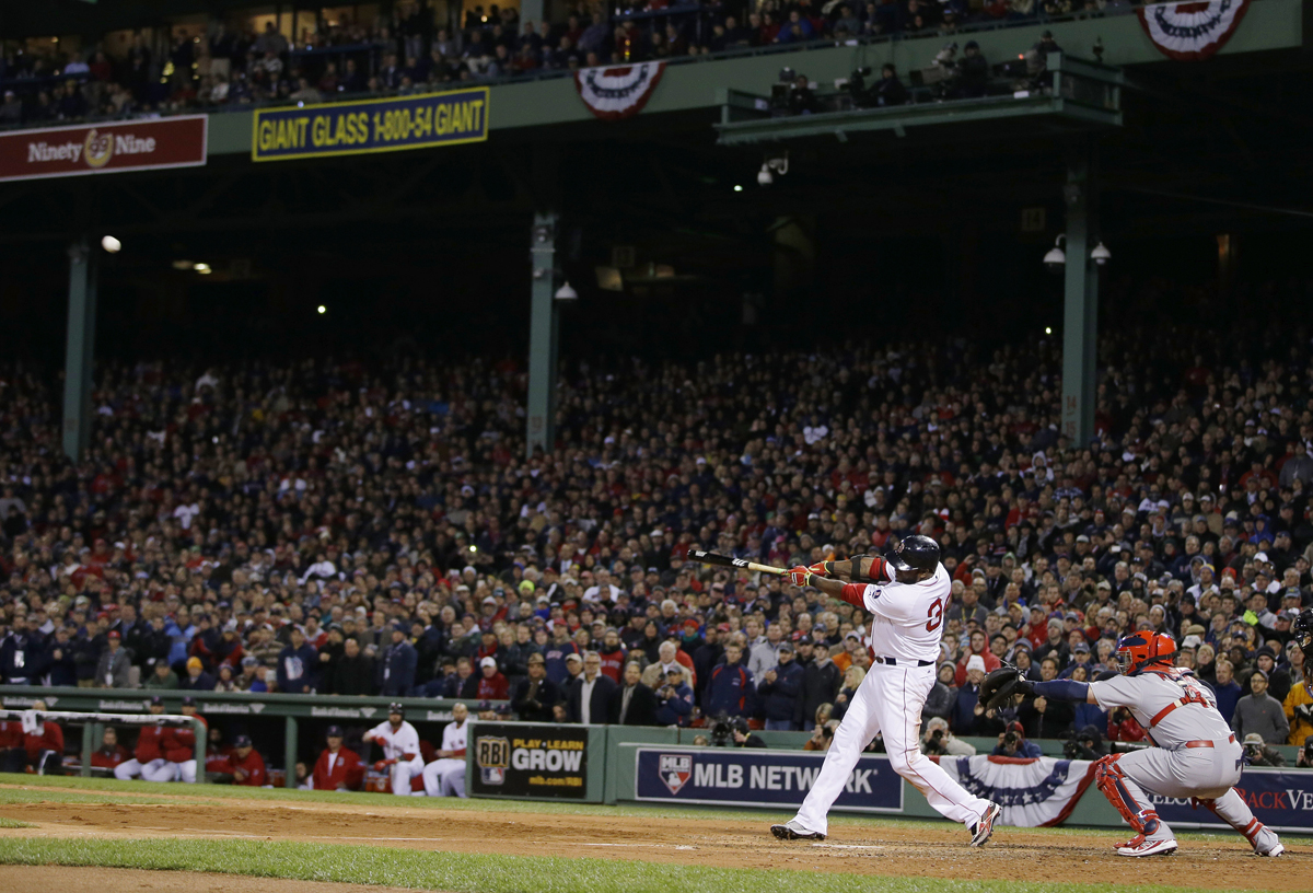 Boston Red Sox's David Ortiz hits a two-run home run during the sixth inning of Game 2 of baseball's World Series against the St. Louis Cardinals Thursday, Oct. 24, 2013, in Boston. (AP Photo/Matt Slocum)